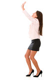 Business woman lifting something Royalty Free Stock Photos