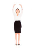 Business woman lifting something Stock Photography