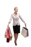 Business woman in a light beige suit holding shopping bags Stock Photo