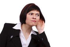 Business woman listening gossip Royalty Free Stock Photos