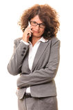 Business woman listening on smartphone Stock Image