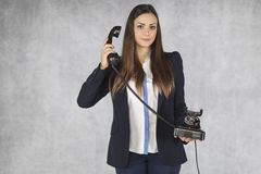 Business woman listens to a customer on the phone. Businesswoman listens to a customer on the phone Stock Photos