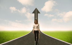 Business woman lokking at 3d road with up arrow Royalty Free Stock Photos