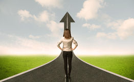 Business woman lokking at 3d road with up arrow Royalty Free Stock Images