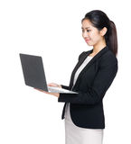 Business woman look at computer Stock Image