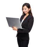 Business woman look at laptop computer Stock Image