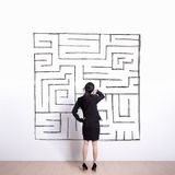 Business woman look maze Royalty Free Stock Photo
