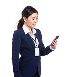 Business woman look at mobile phone Royalty Free Stock Photography