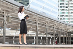 Business woman look something and write massage on her book Royalty Free Stock Photo