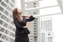 Business woman look up and flick her hair at outdoor. Business and Beauty concept royalty free stock images