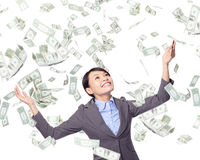 Business woman look up under money rain royalty free stock photography