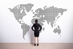 Business woman look world map Royalty Free Stock Photo