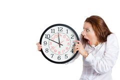 A business woman looking anxiously at a clock Stock Photography