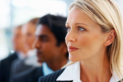 Business woman looking away with colleagues Royalty Free Stock Images