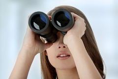 Business woman looking through binocular Stock Image