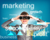 Business woman looking through binoculars Royalty Free Stock Images