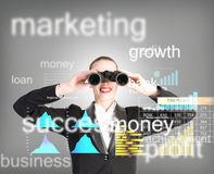 Business woman looking through binoculars. Concept search solutions in business Royalty Free Stock Image