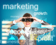 Business woman looking through binoculars. Concept search solutions in business Stock Photos