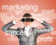 Business woman looking through binoculars. Concept search solutions in business Royalty Free Stock Photos