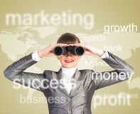 Business woman looking through binoculars. Concept search solutions in business Royalty Free Stock Photo