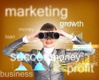 Business woman looking through binoculars Stock Image