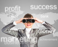 Business woman looking through binoculars Royalty Free Stock Photography