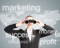Business woman looking through binoculars. Concept search solutions in business Stock Photography