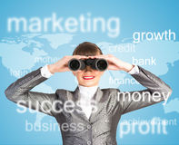 Business woman looking through binoculars. Concept search solutions in business Stock Images