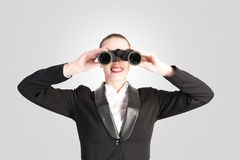 Business woman looking through binoculars Royalty Free Stock Photo