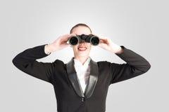 Business woman looking through binoculars Royalty Free Stock Photo