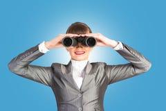 Business woman looking through binoculars Stock Photography