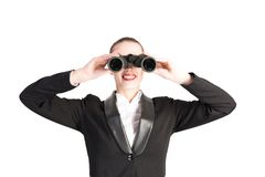 Business woman looking through binoculars Stock Photo