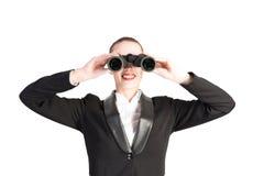 Business woman looking through binoculars Stock Photo