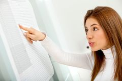 Business woman looking at a chart Stock Photography