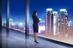Business woman looking the city from his office room Royalty Free Stock Image