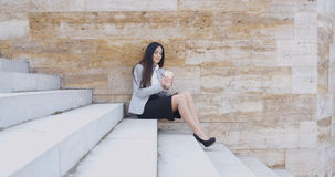 Business woman looking at coffee cup Stock Photo