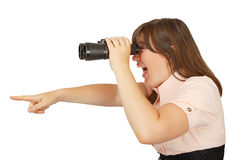 Business woman looking with her binocular and pointing to the co Royalty Free Stock Photo