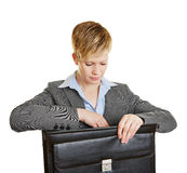 Business woman looking into her briefcase Stock Image