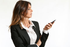 Business woman looking at her mobile phone Stock Photos