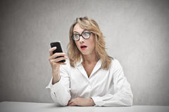 Business woman looking at her phone Royalty Free Stock Image
