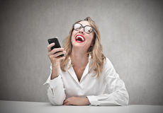 Business woman looking at her phone Royalty Free Stock Photography