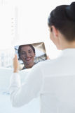 Business woman looking at her reflection in tablet PC Stock Photos