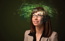 Business woman looking at high tech number calculations Royalty Free Stock Image