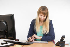 Business woman looking at his watch and schedule of the working day Royalty Free Stock Image