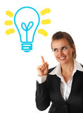 Business woman looking at lamp with rised finger Royalty Free Stock Image