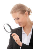 Business woman looking into a magnifying glass Royalty Free Stock Images