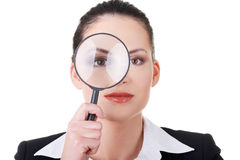 Business woman looking through magnifying glass. Stock Photography