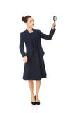 Business woman looking into a magnifying glass Stock Photos