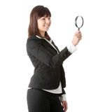 Business woman looking into a magniying glass Royalty Free Stock Images