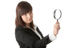 Business woman looking into a magniying glass Royalty Free Stock Photography